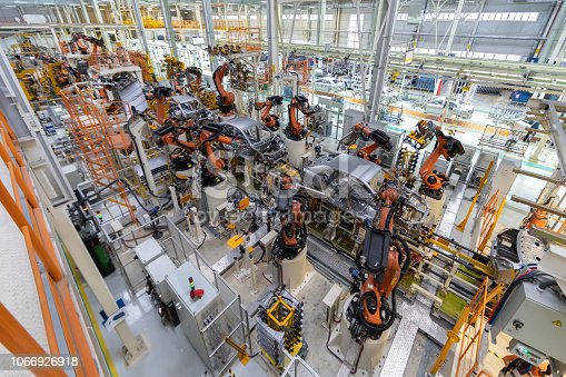 538617741 istock photo body of car on conveyor top view. Modern Assembly of cars at the plant. The automated build process of the car body 1066926918