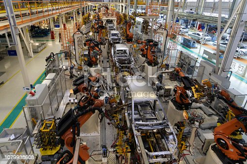 1069360792 istock photo body of car on conveyor top view. Modern Assembly of cars at the plant. The automated build process of the car body 1079938608