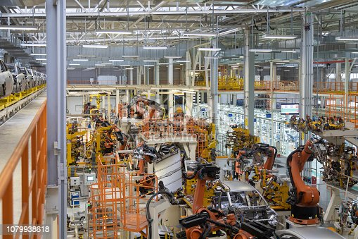 1069360792 istock photo body of car on conveyor top view. Modern Assembly of cars at the plant. The automated build process of the car body 1079938618