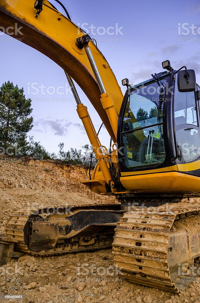 Body of the excavator photographed at dusk stock photo