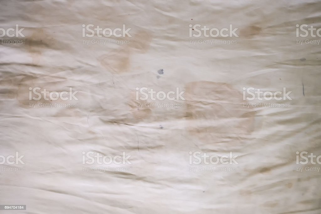 Body oil stains,odors and stains,other dirt on white bedding sheet stock photo