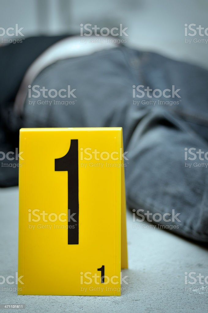 Body on the floor numbered with a yellow 1 at a crime scene royalty-free stock photo