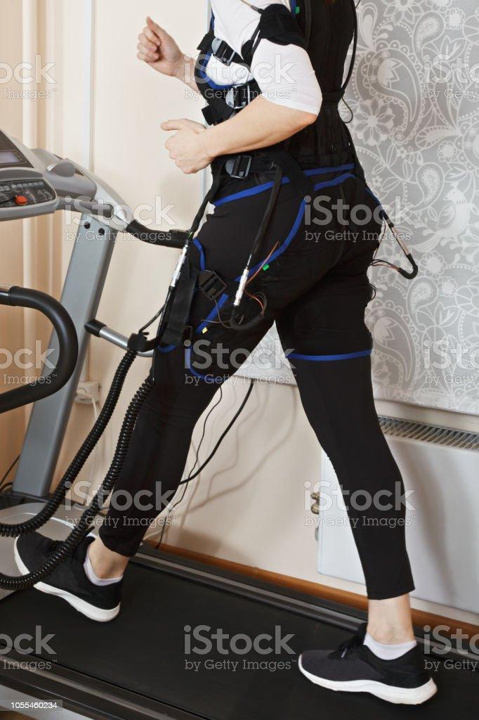 Body on treadmill stock photo