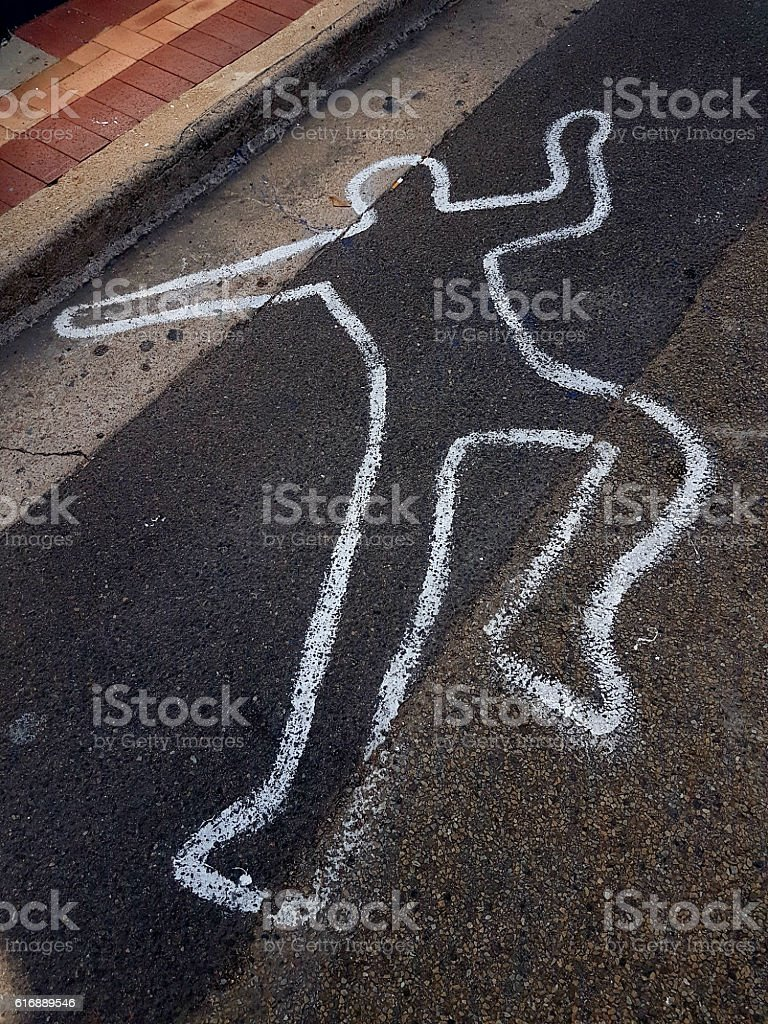 Body outline on road stock photo