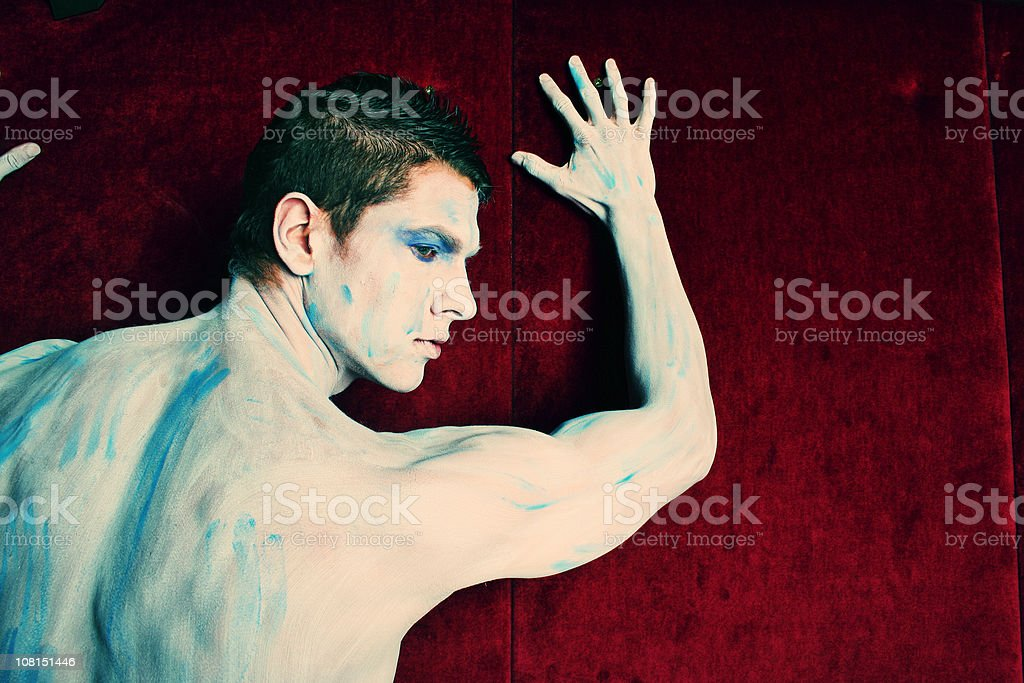 Body Painted Man Posing Against Wall royalty-free stock photo