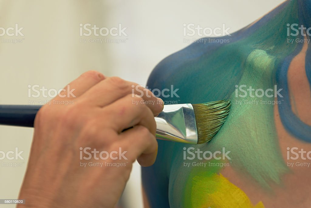 Body painting in process stock photo