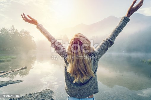 istock Body positive girl enjoying freedom in nature 868623210