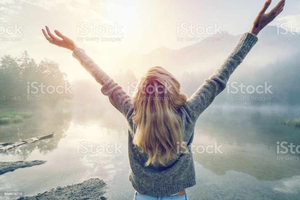 Body positive girl enjoying freedom in nature stock photo