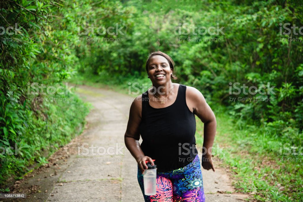 Body positive woman exercising in nature stock photo