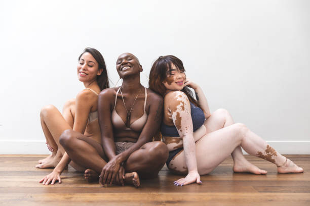 Body positivity - women friends posing at home in lingerie Body positivity - women friends posing at home in lingerie body positive stock pictures, royalty-free photos & images
