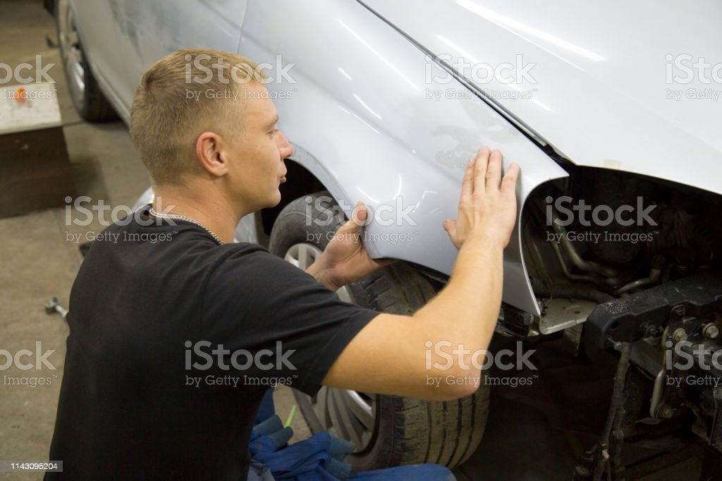 Body repair of the car. Painting the car.