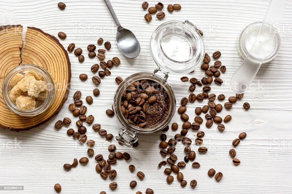 Body scrub of ground coffee top view on wooden table zbiór zdjęć royalty-free