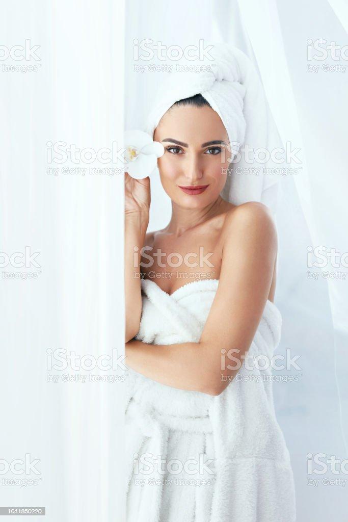 Body Skin Care. Beautiful Woman In Towel In Beauty Spa Salon With...