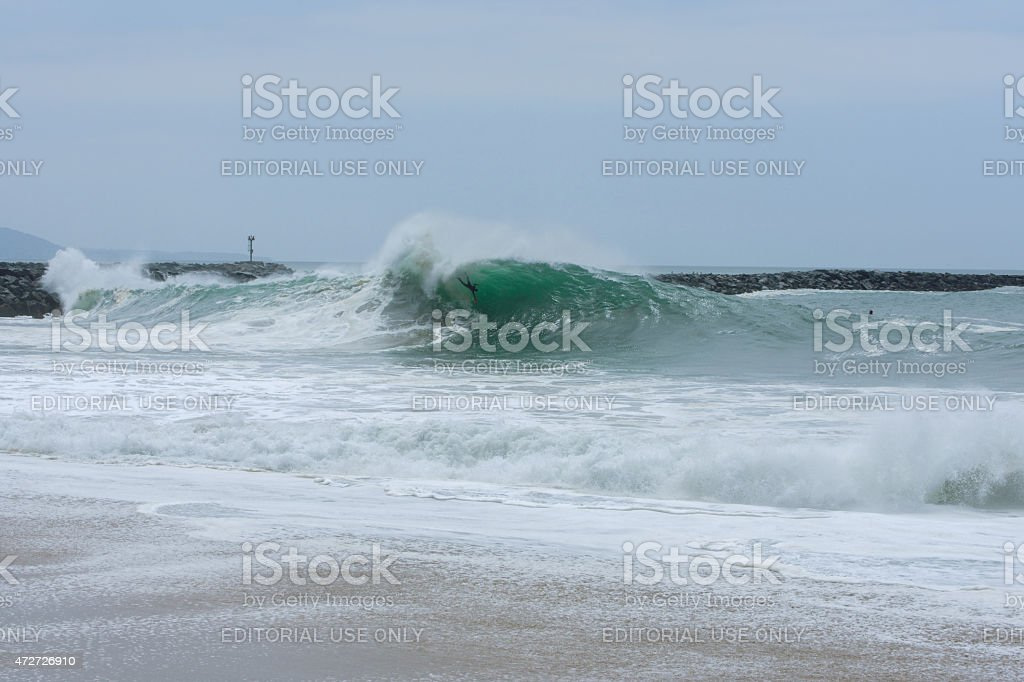 Body surfer tossed in huge wave at The Wedge stock photo