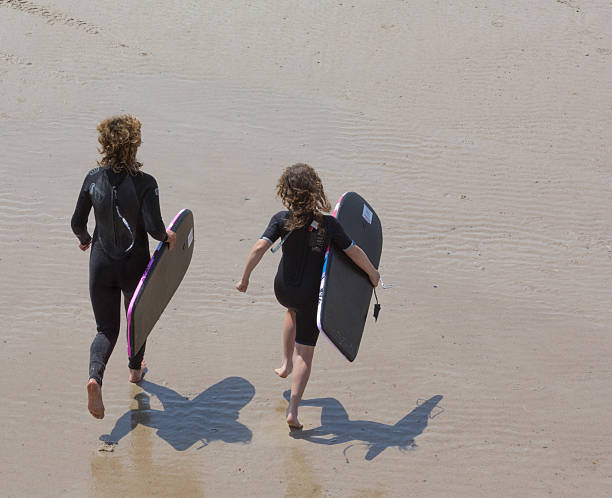 Body Surfers at St Ouen stock photo