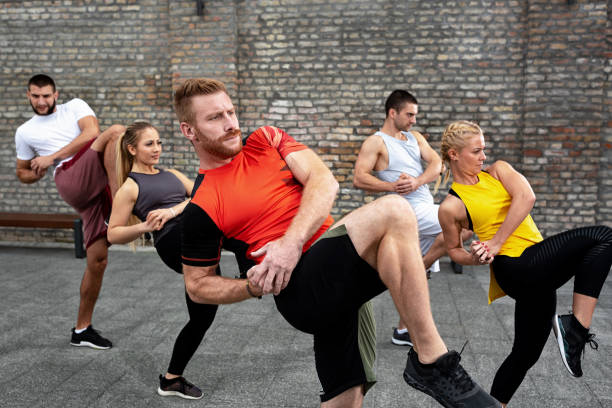 Body training concept based on combining fitness and martial arts, street combat stock photo