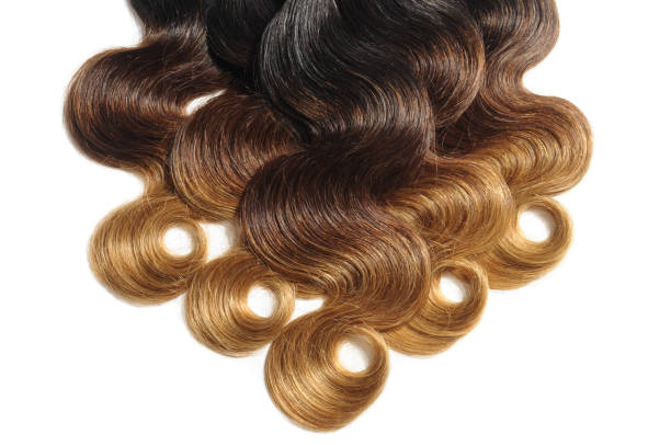 Body wavy black to brown to blonde three tone ombre human hair weaves extensions bundles stock photo