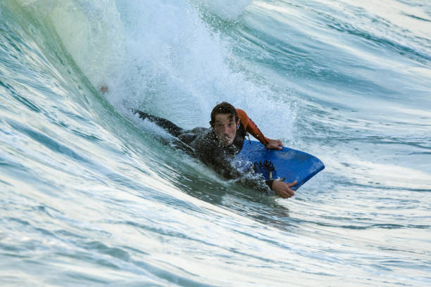 Bodyboarder in action stock photo