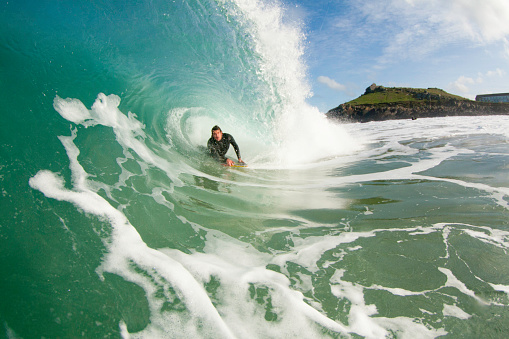 Bodyboarder in the ocean riding a wave