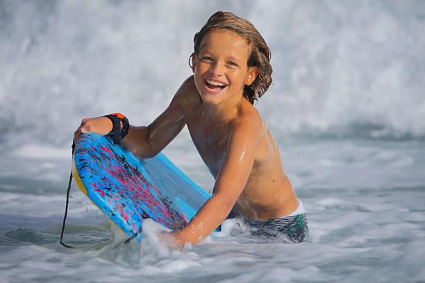 BodyBoarding Kid stock photo