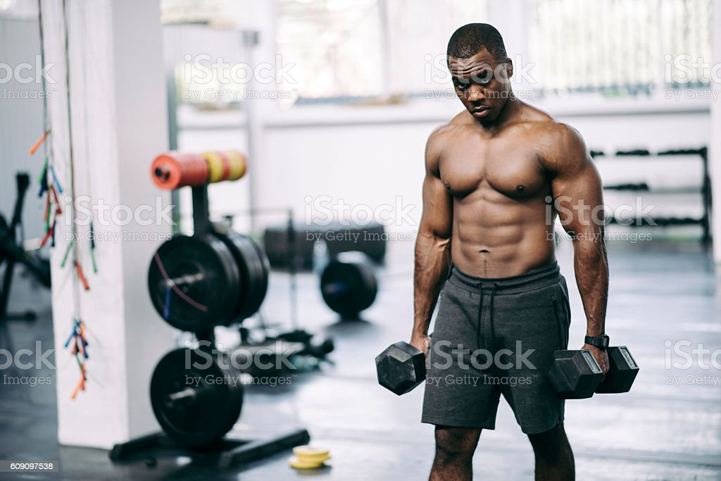 Bodybuilder at the gym stock photo