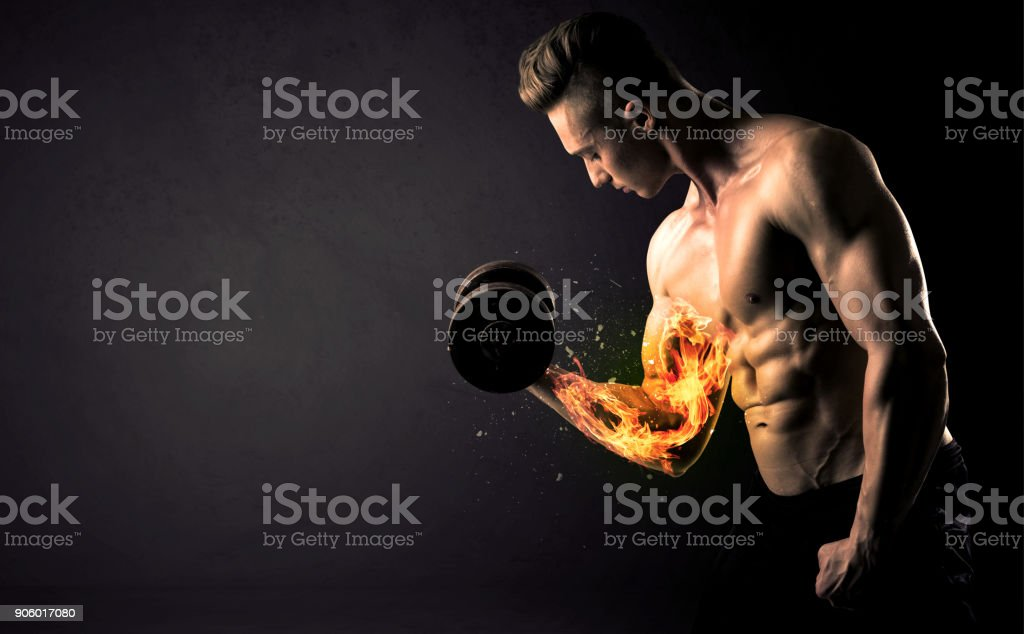 Bodybuilder athlete lifting weight with fire explode arm concept stock photo
