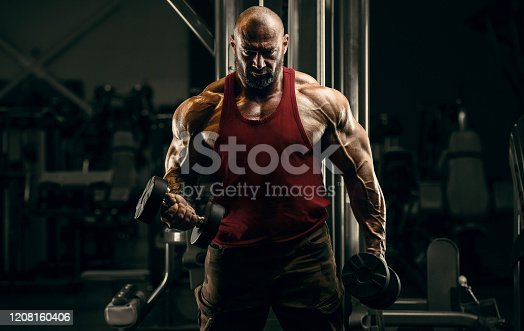 Bodybuilder handsome strong athletic rough man pumping up biceps muscles workout fitness and bodybuilding healthy concept background - muscular fitness men doing arms exercises in gym naked torsoBodybuilder handsome strong athletic rough man pumping up back muscles deadlift workout fitness and bodybuilding healthy concept background - muscular fitness men doing arms exercises in gym naked torso