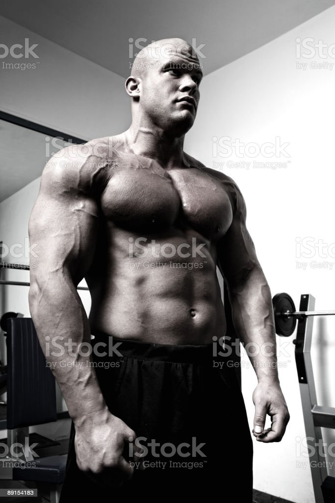 Bodybuilder by the fitness machine royalty-free stock photo