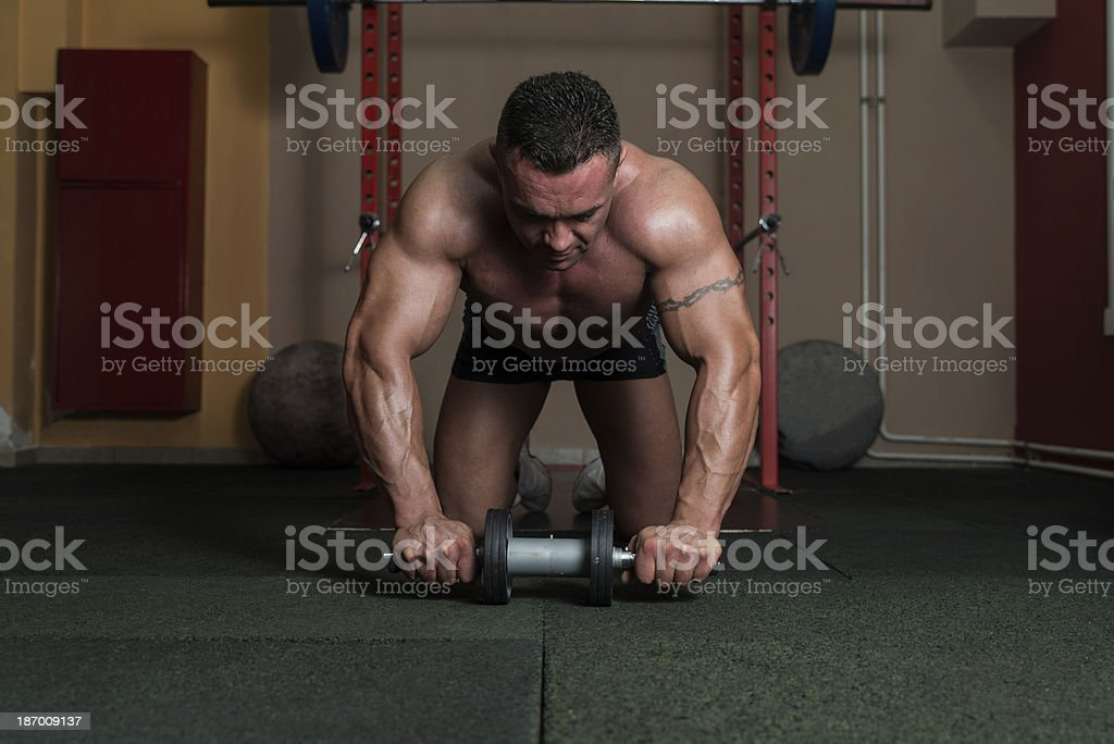 Bodybuilder Doing Abs Exercise stock photo