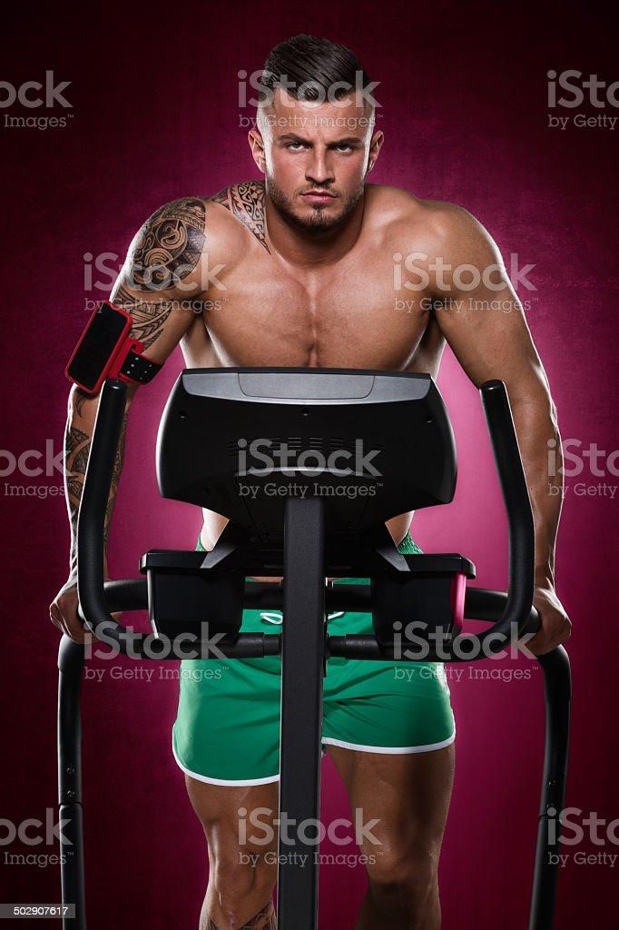 Bodybuilder doing cardio royalty-free stock photo