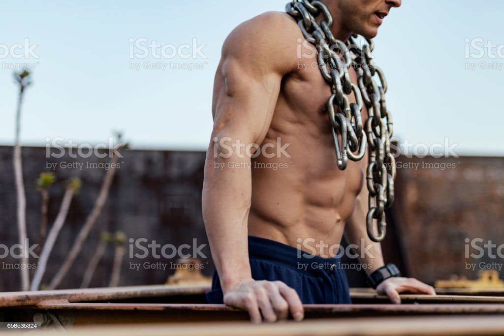 Bodybuilder doing dips stock photo