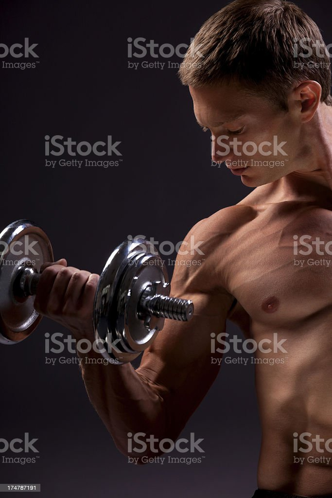 Bodybuilder doing exercises with weight royalty-free stock photo