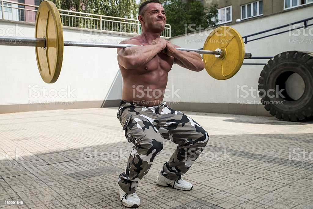 Bodybuilder Doing Front Squats With Barbells royalty-free stock photo