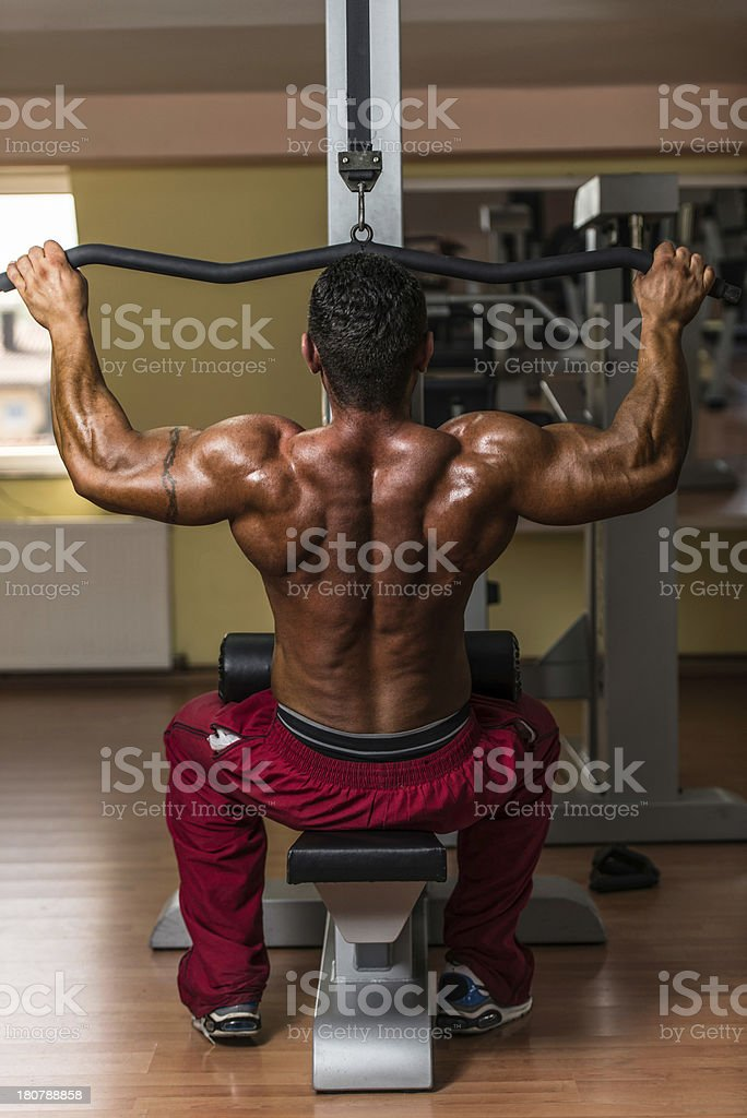 bodybuilder doing heavy weight exercise royalty-free stock photo