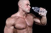 istock Bodybuilder drinking water 92360528