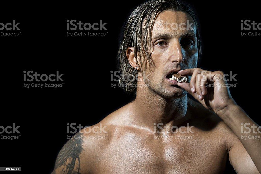 Bodybuilder Eating Chocolate stock photo
