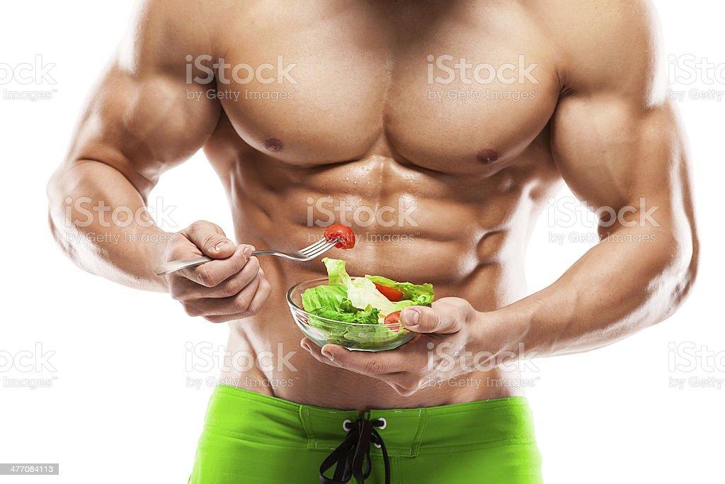 Bodybuilder comiendo ensalada - Foto de stock de Comer libre de derechos