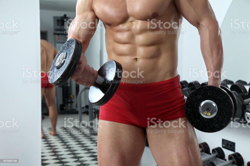 Bodybuilder exercising in gym royalty-free stock photo