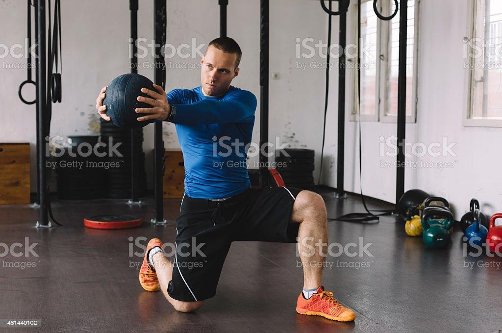 Bodybuilder exercising in the gym stock photo