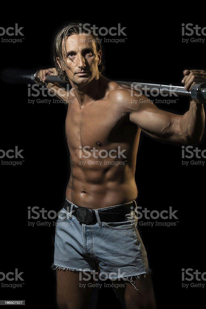 Bodybuilder Exercising Isolated On Black Background royalty-free stock photo