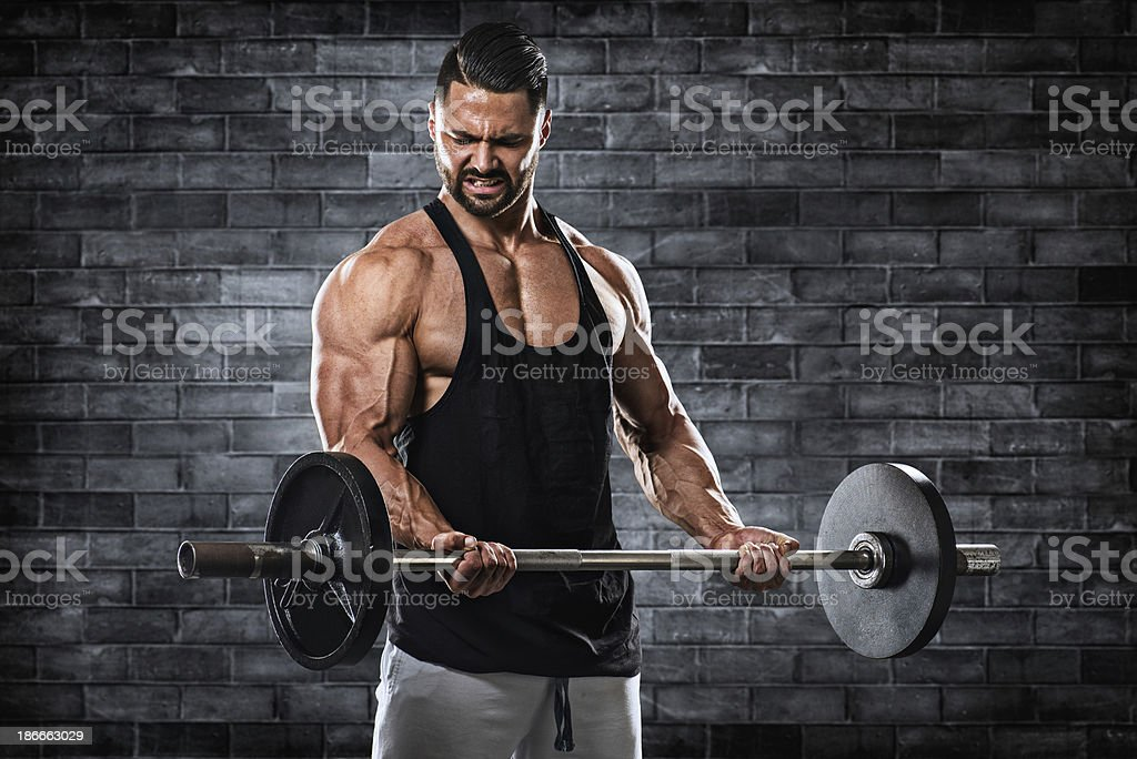 Bodybuilder exercising with barbell royalty-free stock photo