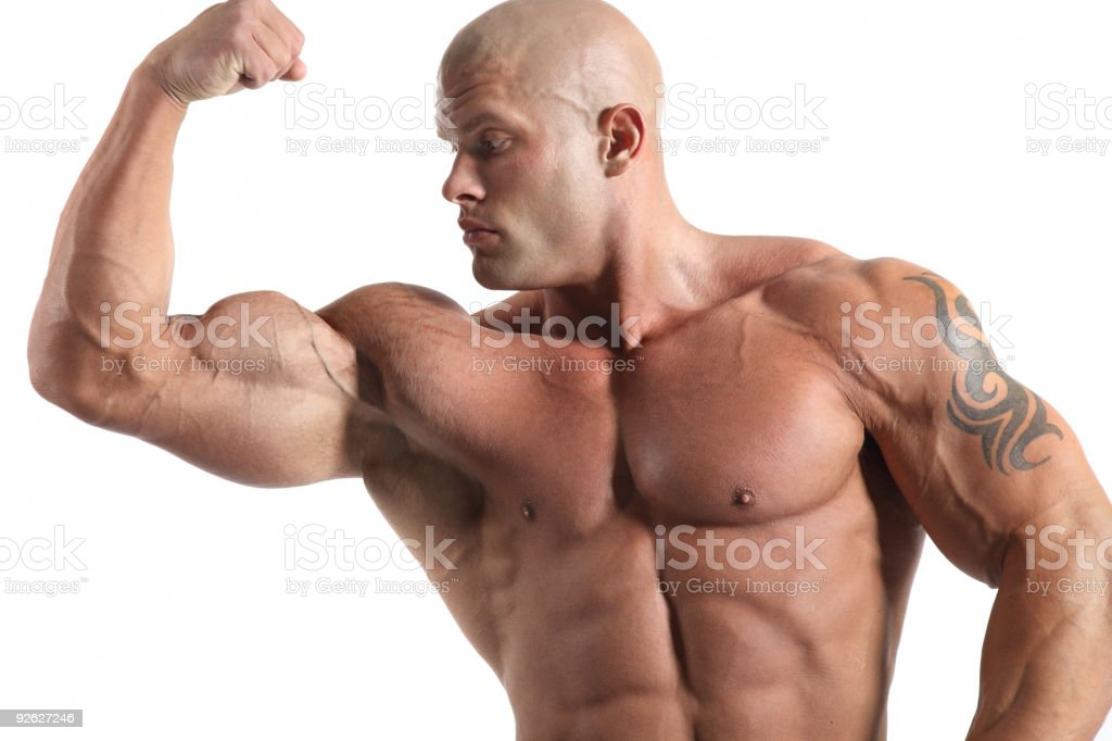 Bodybuilder flexing muscles to show off his strength royalty-free stock photo