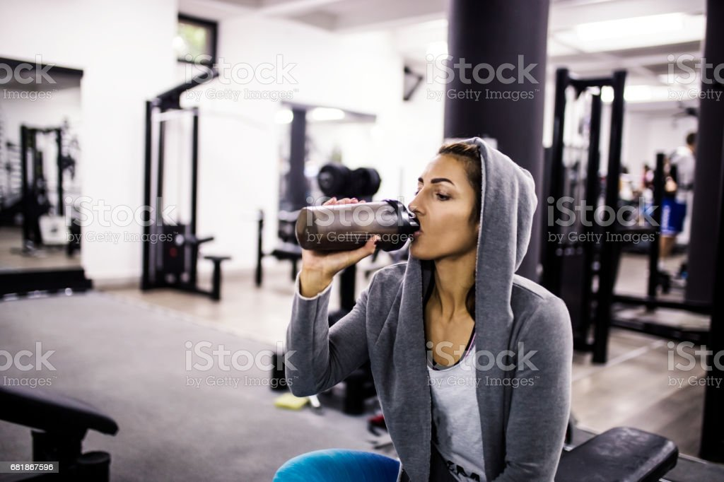 Bodybuilder girl relax after exhausting training stock photo