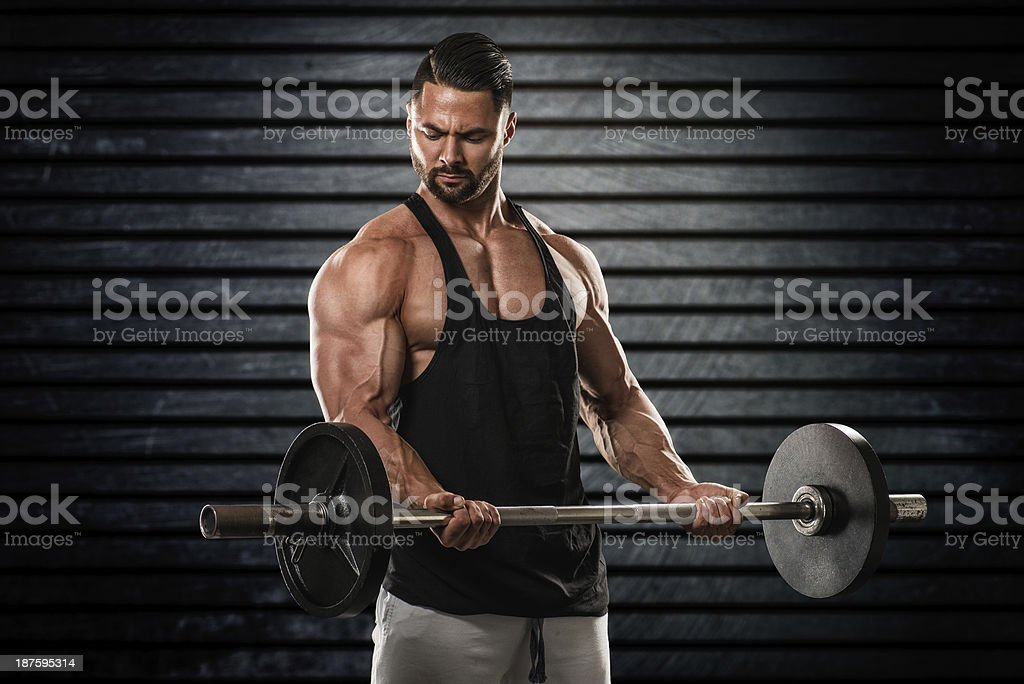 Bodybuilder holding barbell royalty-free stock photo