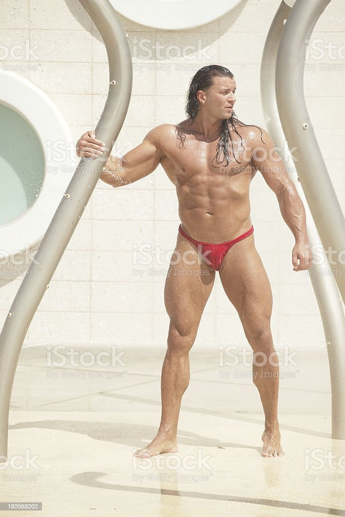 Bodybuilder in a speedo stock photo
