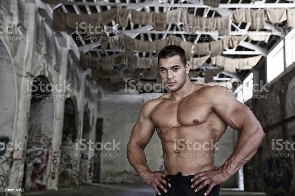 Bodybuilder in abandoned factory royalty-free stock photo