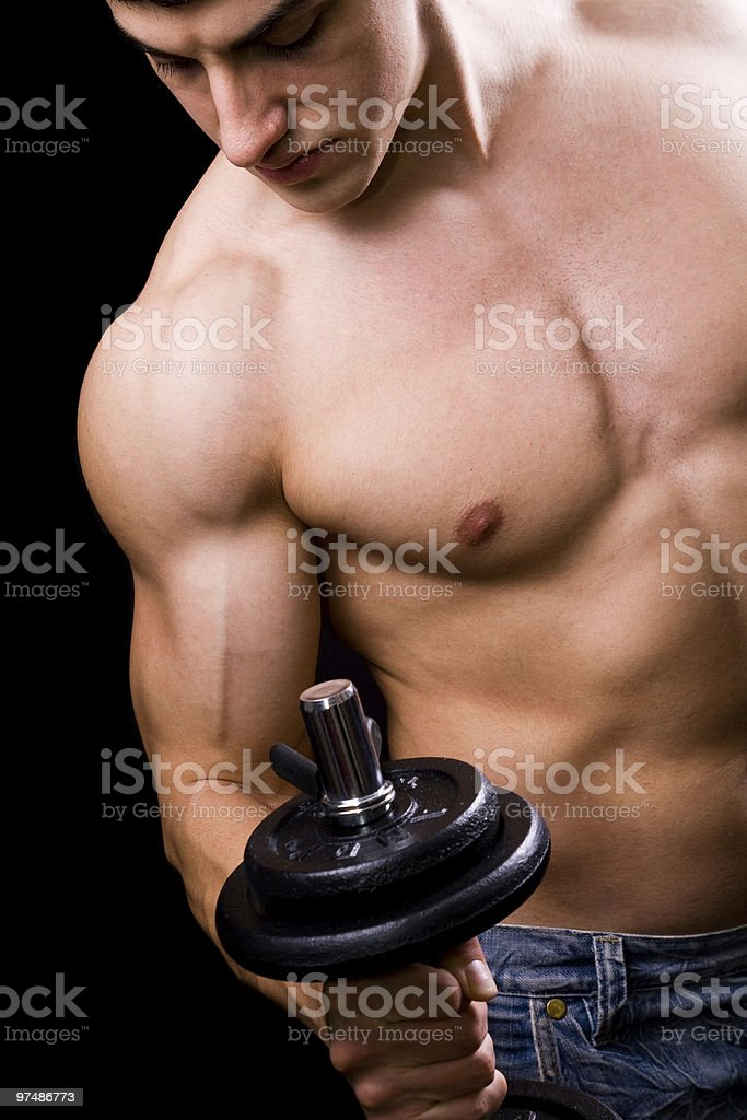 Bodybuilder in action - muscular powerful man lifting weights royalty-free stock photo