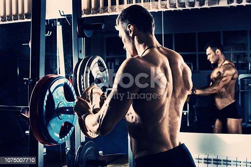 istock bodybuilder in gym 1075007710