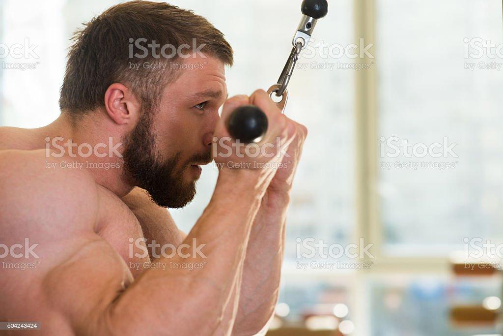 Bodybuilder in gym. stock photo