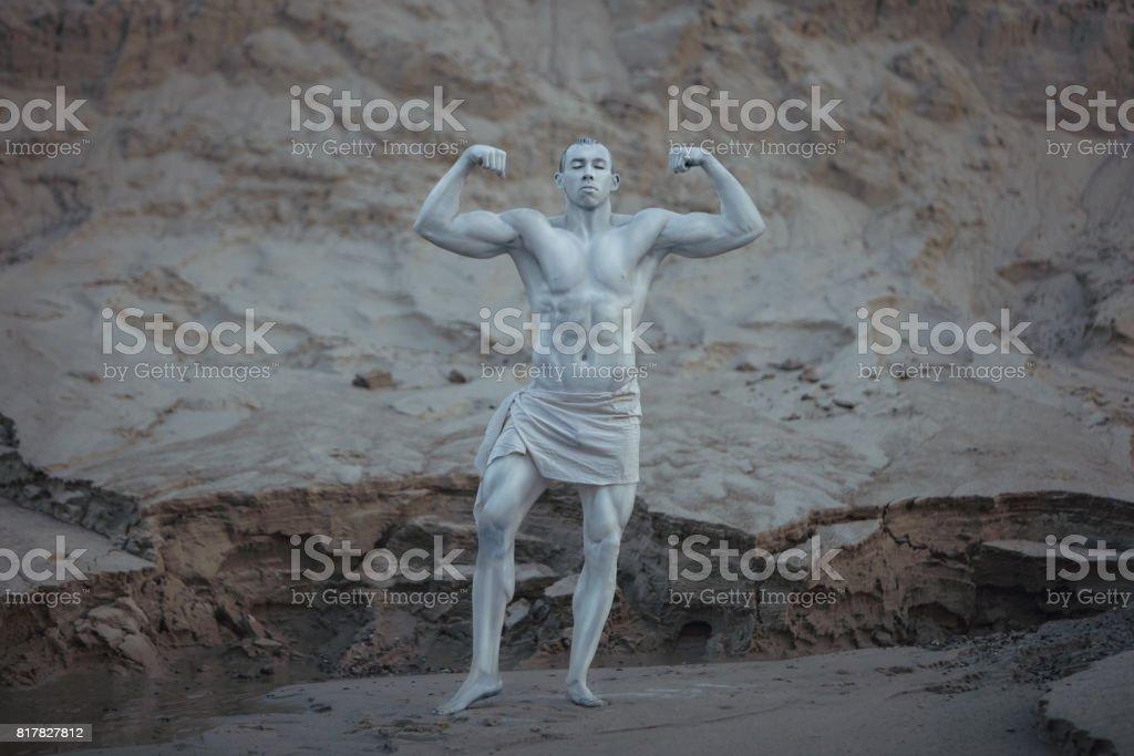 Bodybuilder male statue. stock photo